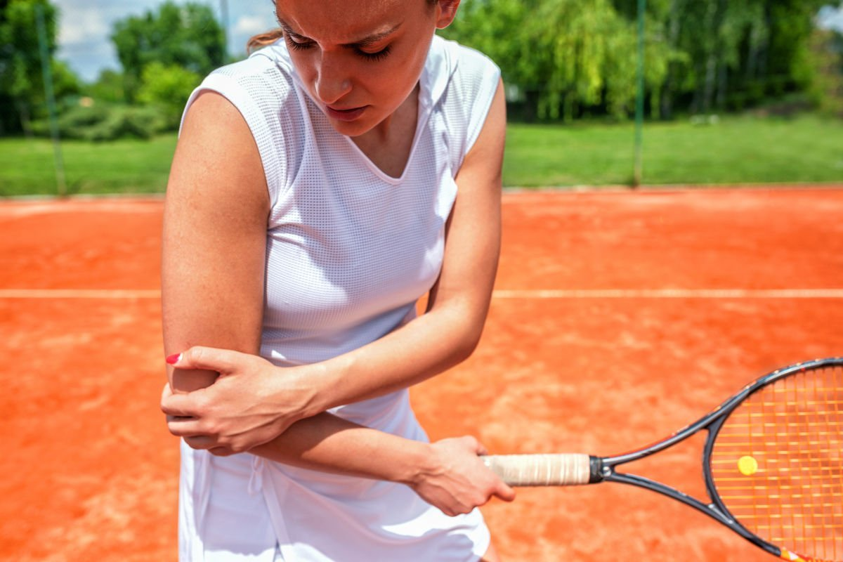photo of a female tennis player with a tennis elbow