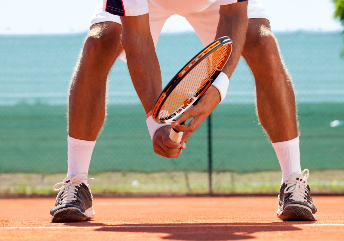 Foto van een tennisser met tennissokken